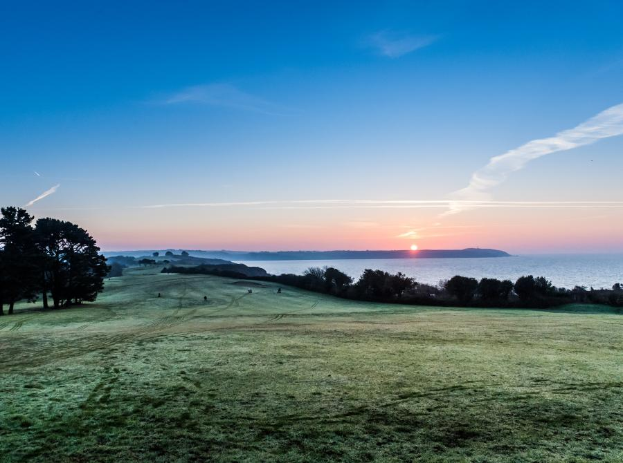 View of sunrise above gibon taken from Carlyon Bay golf course