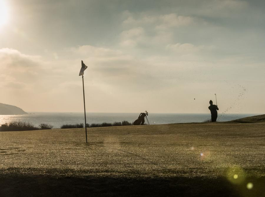 golfer taking shot on 3rd Green to Gribbon at carlyon bay