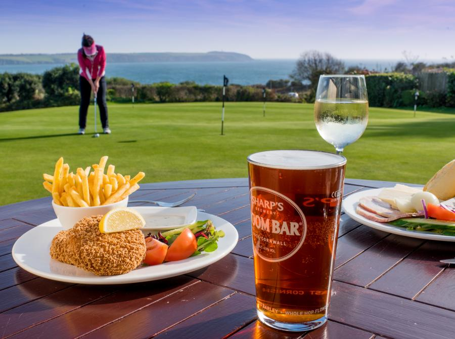 lunch and pint on table on terrace at Carlyon Golf Clubhouse