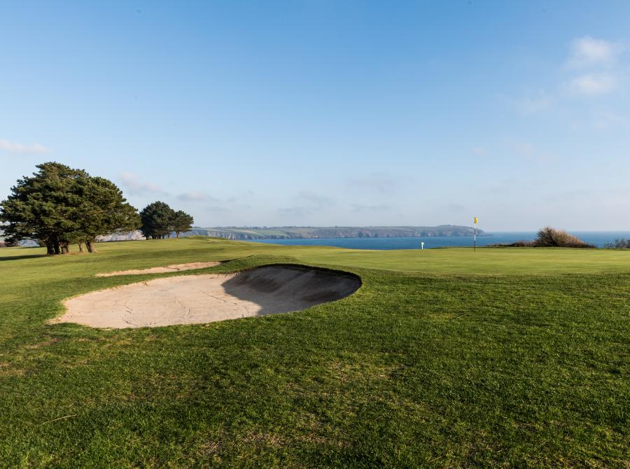 view of 8th Green bunker with sea at carlyon bay