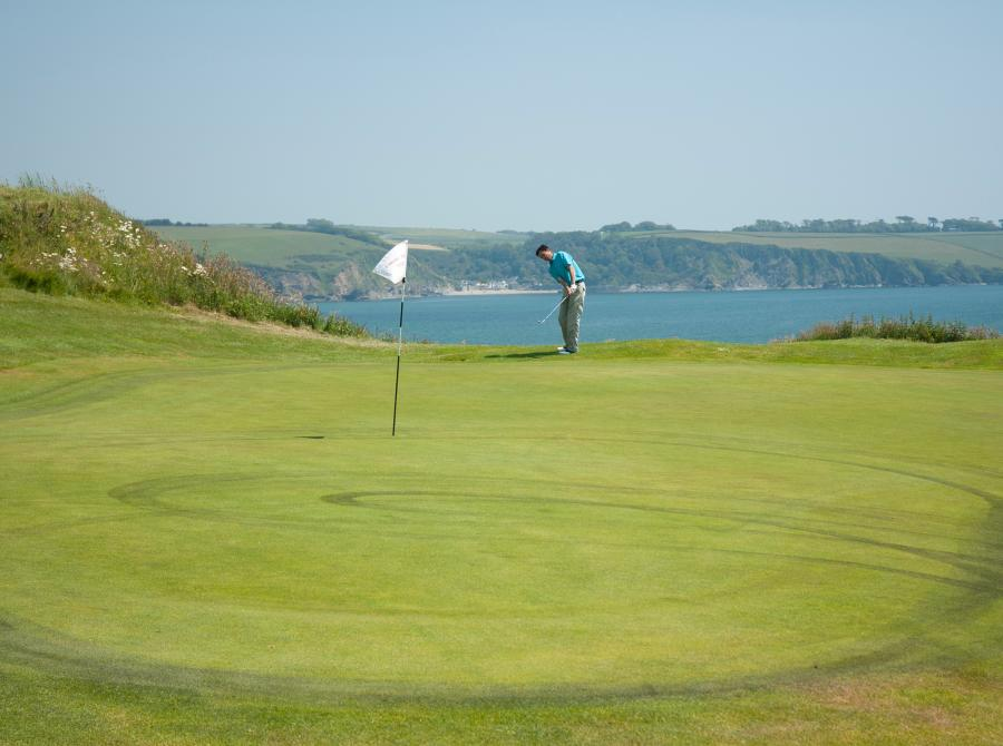 9th green with view of polkerris in distance